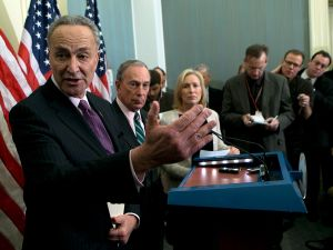 Senator Chuck Schumer discussing post-Sandy federal aid at the Capitol Building yesterday with Mayor Michael Bloomberg and Kirsten Gillibrand. (Photo: Getty)