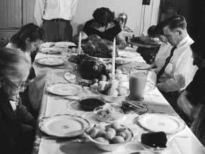 A family prepares to dine on Thanksgiving, circa 1955. (Evans/Three Lions/Getty Images)