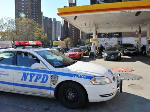 An NYPD car guards a gas station. (Photo: Getty)