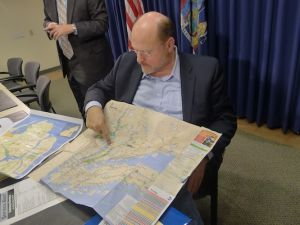 Joe Lhota shows off his custom MetroNorth map. (Matt Chaban)