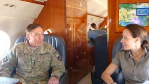 Paula Broadwell and David Petraeus together on a plane. (Photo: PaulaBroadwell.com)