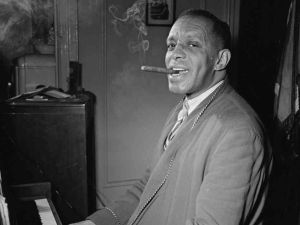 "Those were the days: Pianist Willie ""the Lion"" Smith smoking in his NYC apartment in 1947."