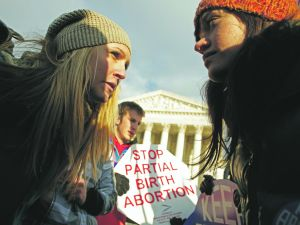 Anti-abortion and pro-choice demonstrators argue in front of the Supreme Court during the March for Life January 24, 2011 in Washington, DC.