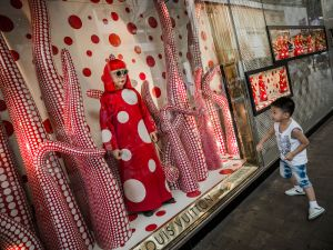 A Kusama display and wax figure at a Louis Vuitton store in Hong Kong. (Philippe Lopez/AFP/Getty Images)
