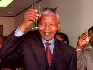 Nelson Mandela enjoying an adult beverage after winning the Nobel Peace Prize in 1993. (Photo: Getty)