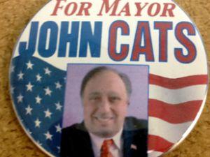One of John Catsimatidis' campaign buttons.