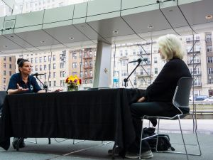 Mierle Laderman Ukeles, right, talking with Brooklyn Museum employee Peggy Johnson. (Photo: Carole DeBeer, courtesy Brooklyn Museum)