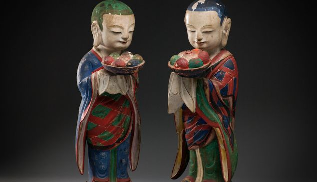 A pair of polychrome wood Buddhist attendants from the 18th or 19th century in Korea. (Courtesy Koo New York)
