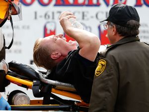 A man is loaded into an ambulance in Boston. (Getty Images)