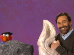 Elmo and Jon Hamm make art. (PBS)