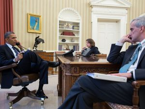 President Barack Obama talks on the phone with FBI Director Robert Mueller to receive an update on the explosions that occurred in Boston, in the Oval Office, April 15, 2013. Seated with the President are Lisa Monaco, Assistant to the President for Homeland Security and Counterterrorism, and Chief of Staff Denis McDonough. (Official White House Photo by Pete Souza)