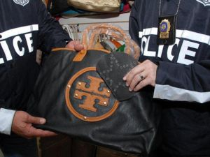 A counterfeit Tory Burch bagged seized by NYPD, featuring the brand's oft-mimicked logo. (NYPD)