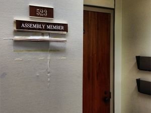 The sign outside Ex-Assemblyman Vito Lopez's office has already been removed. (Photo: Twitter/@thomaskaplan)