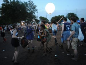 Concert-goers cavort in the mud at the Governors Ball. (Getty)