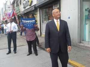 Bill Thompson greets people outside of the Flatbush Avenue-Brooklyn College subway station.