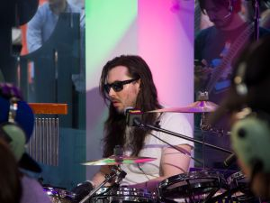 Andrew W.K. drumming at the Oakley store on Time Square. (Photo by Hugh Bassett).