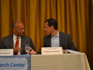 Bill Thompson and Anthony Weiner chatting at the forum.