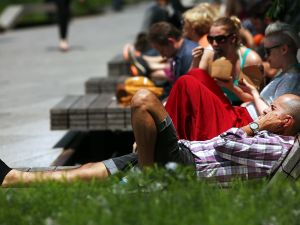 """New Yorkers enjoy the """"slender wooden benches"""" at the High Line."""