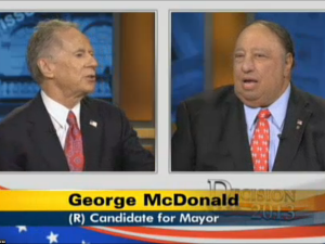 George McDonald and George Catsimatidis sparring at the debate. (Photo: NY1)