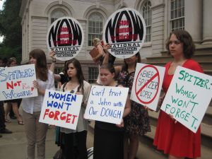 The National Galvanization of Women protested Spitzer's candidacy.