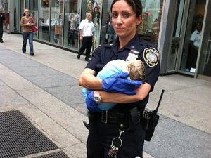 Officer Melissa DeFrancesco with the baby boy. (via Flickr)