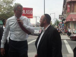 Bill de Blasio walks down 13th Avenue in Boro Park.