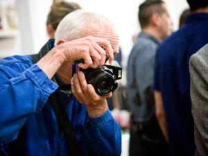Bill Cunningham taking pictures in 2013
