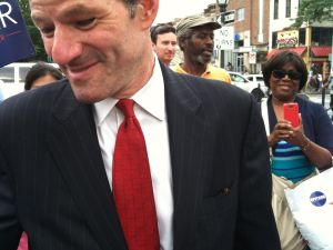 Eliot Spitzer talking business in Crown Heights.