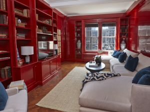 A red library, whose owners were apparently not even interested in pretending that they own readable books.