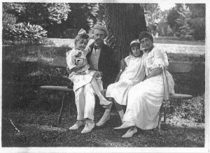 Ms. Clark's, shown here as a tow-headed child with her sister, mother and father. From the book Empty Mansions.