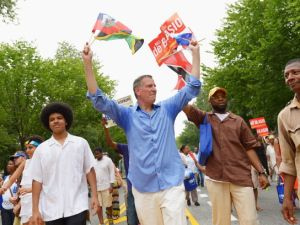 Bill de Blasio campaigns with his son in the West Indian Day Parade. (Photo: Getty)