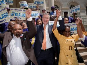 George Gresham (left) celebrates the endorsement of Bill de Blasio.