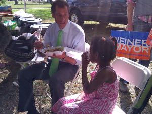Mayoral candidate Anthony Weiner speaks to five-year-old Jayanna Magnus during a cricket match in south Queens today.