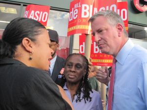 Bill de Blasio speaking to a voter in Harlem this evening.