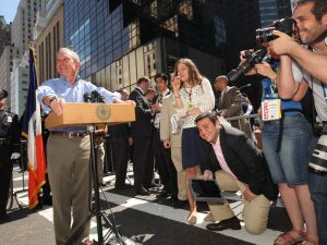Mayor Michael Bloomberg at a press conference as Sally Goldenberg looks on. (Photo: Facebook)
