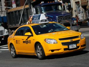 NEW YORK, NY - MARCH 01: A gas-electric hybrid taxi cab drives on a street March 1, 2011 in New York City. The U.S. Supreme Court has decided not to hear an appeal in a case that ends New York City Mayor Mike Bloomberg's four-year fight to force the yellow-taxi industry in New York to fully replace its 13,000 vehicles with gas-electric hybrids. (Photo by Chris Hondros/Getty Images)