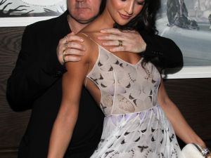 Artist Damien Hirst and Roxie Nafousi at the Tracey Emin dinner hosted by Phillips and Vanity Fair at Cecconi's at Soho Beach House on December 3, 2013 in Miami Beach. (Courtesy Getty Images)