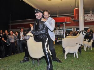 This is art: Michael Shvo and Peter Marino riding a sheep together.