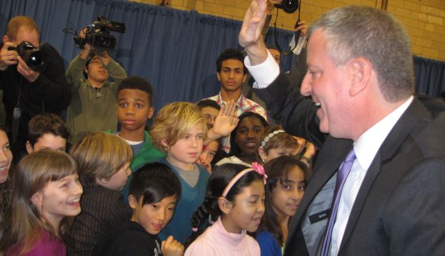 de Blasio high-fives kids after the press conference today.