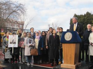 Bill de Blasio standing with parents this afternoon.