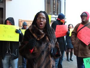 Protest outside of Cuomo meeting.