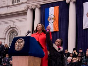 Public Advocate Letitia James with Dasani Coates at Mayor Bill de Blasio's inauguration, with former President Bill Clinton and former Secretary of State Hillary Clinton in the background (Photo: William Alatriste)