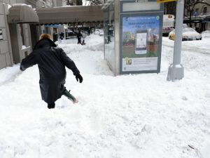 A pedestrian struggles to walk through deep snow in New York on December 27, 2010 . Photo: Timothy A. Clary/AFP/Getty Images).