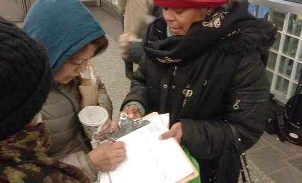 A volunteer collecting signatures this morning in the Bronx. (Photo: Twitter/UPKNYC)