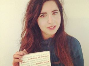 Katzeff with Primary Information's 2013 reissue of Something Else Press' 'An Anthology of Concrete Poetry' (1967). (Courtesy Facebook)