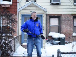 Mayor Bill de Blasio shoveling snow outside his house. (Photo: NYC Mayor's Office)
