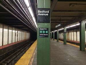 """A sign on Bedford Avenue reads """"Board here for transfer to the 4/5/6 trains."""" (Photos by EPP)."""