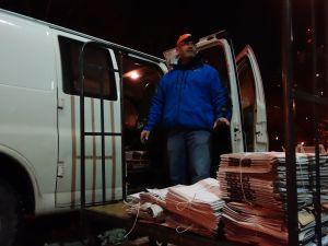 Brian Carey making morning deliveries. (Photo: Molly Dektar)
