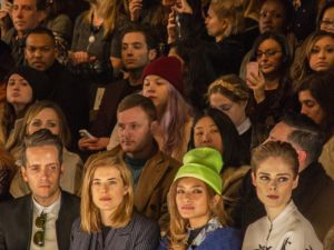 Coco Rocha watches the Rebecca Minkoff show from the front row.