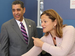 Melissa Mark-Viverito introduces Adriano Espaillat to constituents.